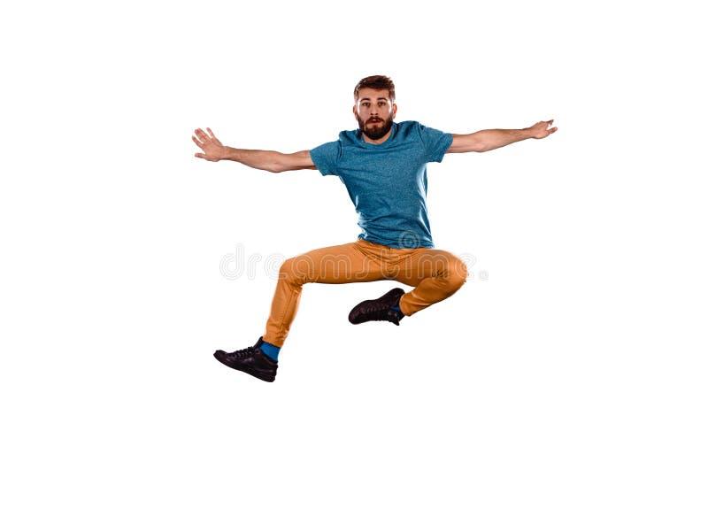Un homme danse en sautant image libre de droits