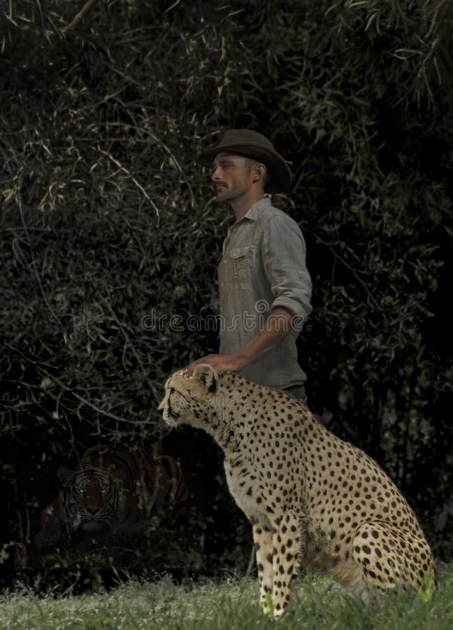 Un homme et son guépard photographie stock