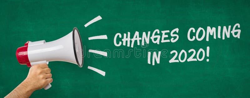 Un homme tenant un mégaphone - Changements à venir en 2020 image stock