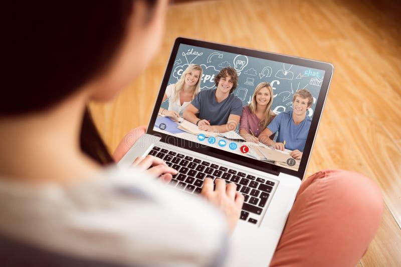 Un'immagine composita di quattro studenti che esaminano la macchina fotografica fotografia stock libera da diritti