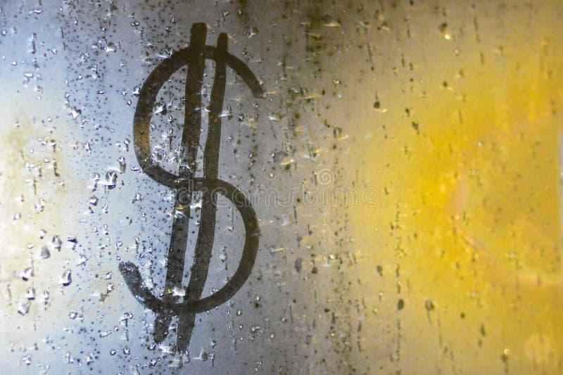 Un'immagine di un dollaro su una finestra appannata Concetto: finanza, destabilizzazione fotografie stock libere da diritti