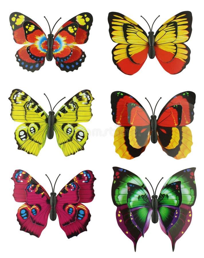 Un insieme dell'album per ritagli di sei di farfalle artificiali luminose colorate multi fotografia stock libera da diritti