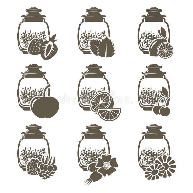 Un insieme di 9 barattoli di vetro del tè del peso con differenti sapori dei frutti e delle erbe fotografie stock