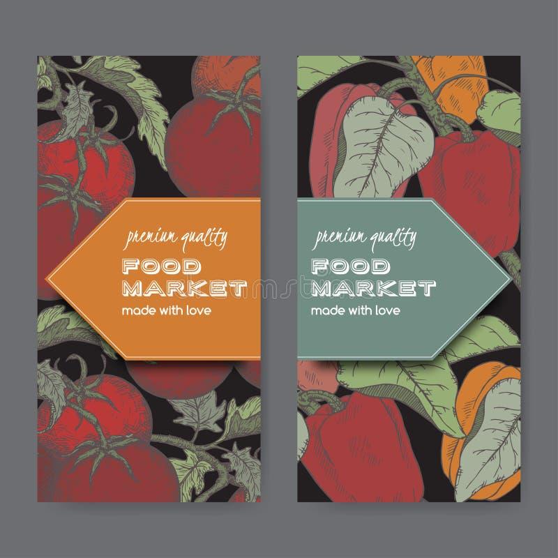 Un insieme di due etichette di colore con i pomodori ed i peperoni freschi sul nero royalty illustrazione gratis