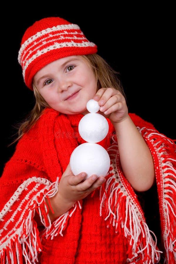 Un inverno della ragazza del bambino che porta i vestiti sta tenendo una l fotografie stock