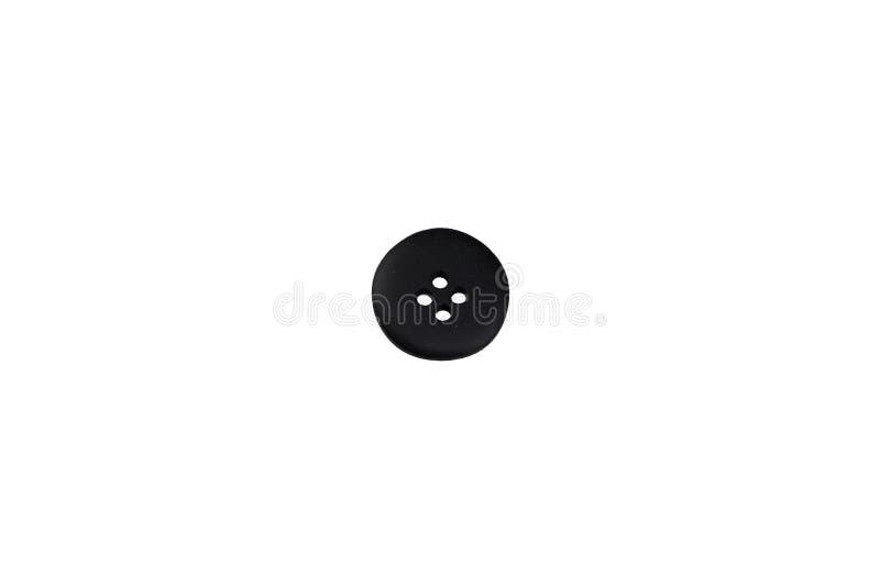 Un isolato nero del bottone dell'abbigliamento fotografie stock libere da diritti