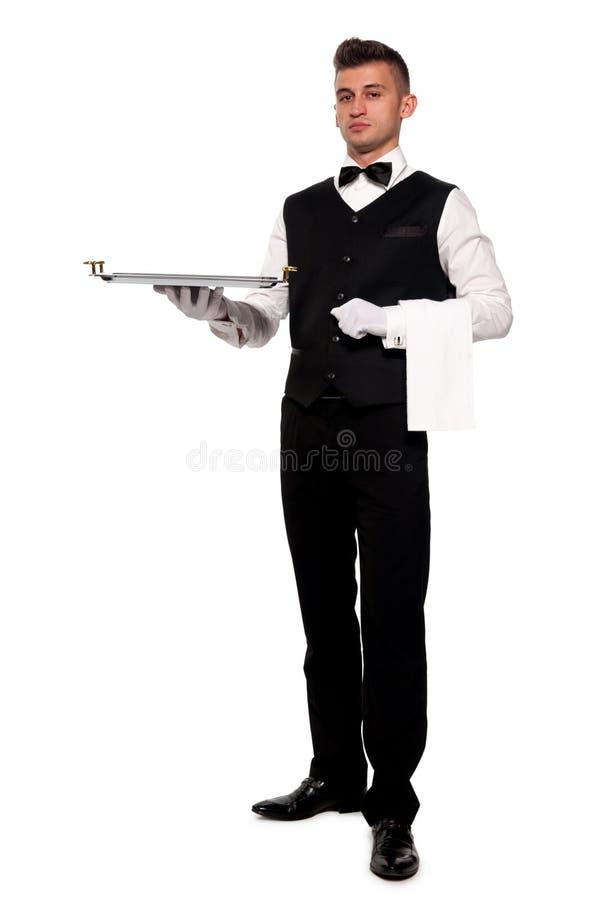 Un jeune serveur de garçon avec un plateau photos libres de droits