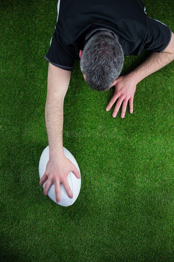 Download Un Joueur De Rugby Marquant Un Essai Image stock - Image du vert, nu: 56486175