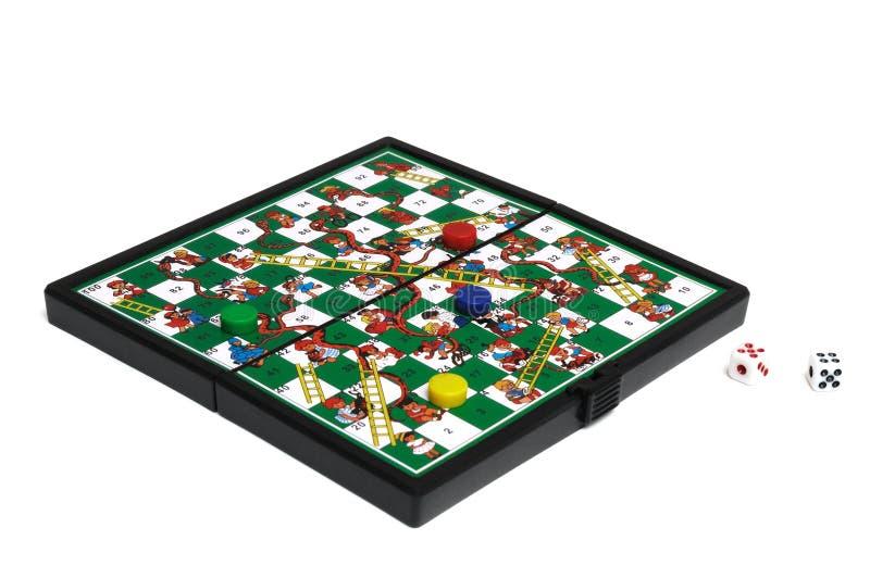 Un juego de serpientes y de escaleras imagen de archivo