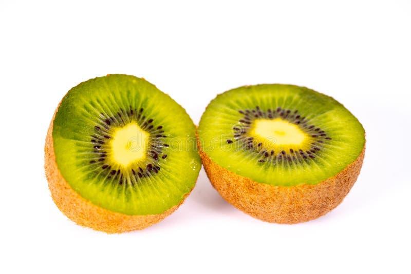 Un kiwi affettato fotografia stock libera da diritti