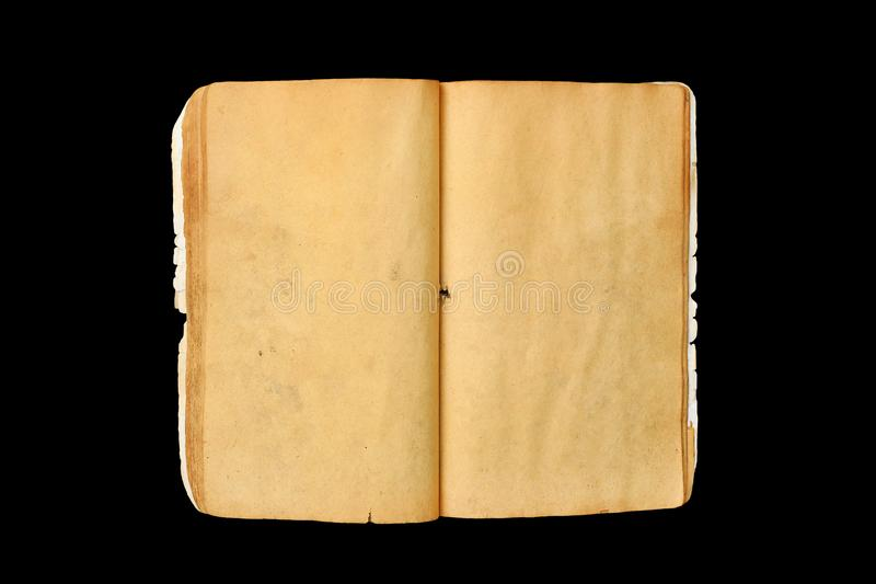 Un libro abierto viejo con amarillo en blanco manchó las páginas aisladas en fondo negro imágenes de archivo libres de regalías