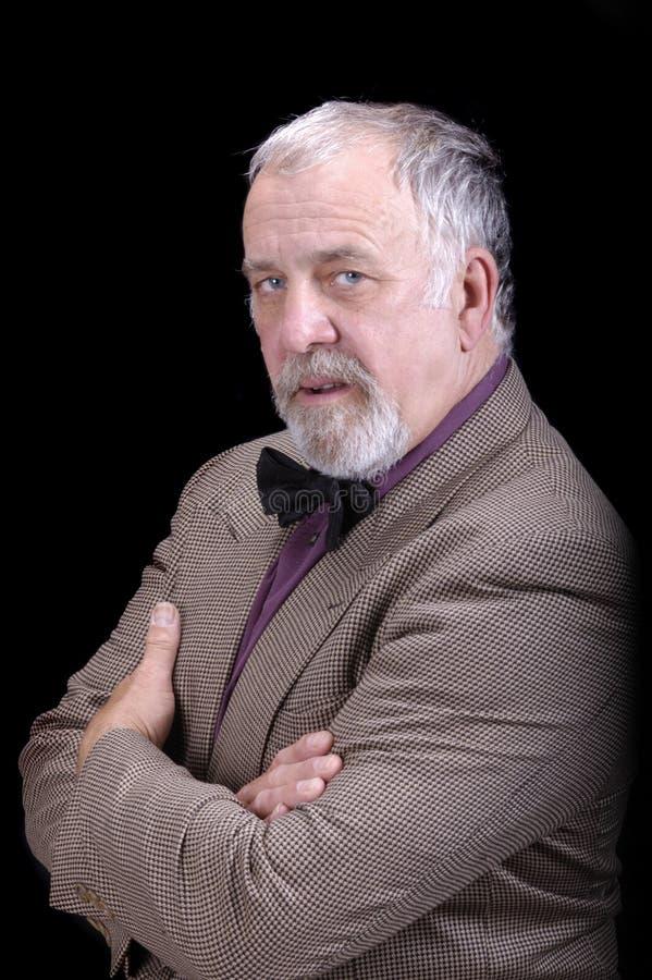 Un más viejo hombre de negocios o profesor foto de archivo