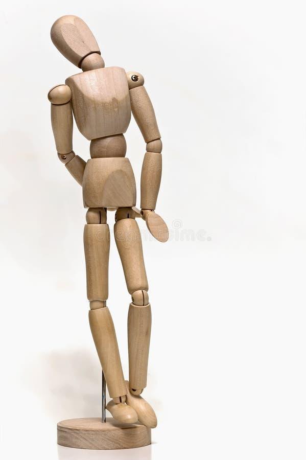 Un mannequin articulé en bois comme aide dans le dessin photographie stock