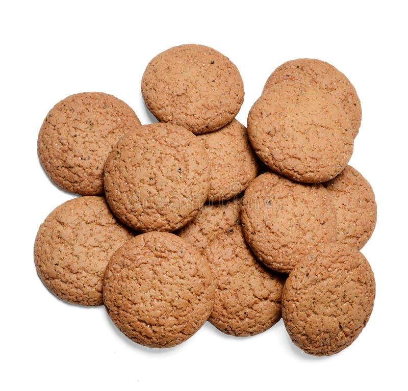Un manojo de galletas de harina de avena en un fondo aislado blanco Primer Visi?n superior fotografía de archivo libre de regalías
