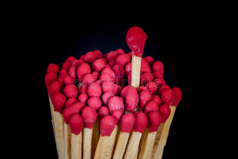 Un matchstick que se coloca encima del grupo, imagenes de archivo