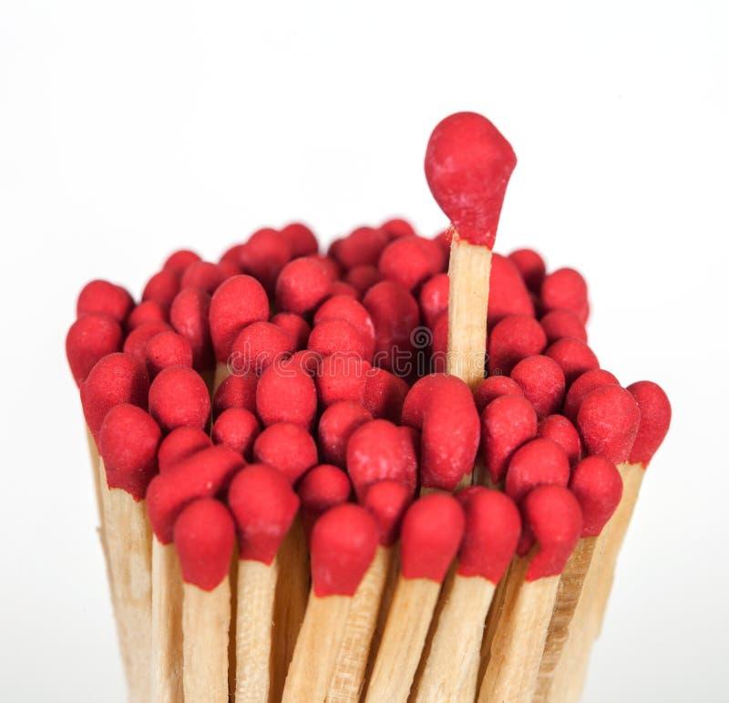 Un matchstick que se coloca encima del grupo, imagen de archivo