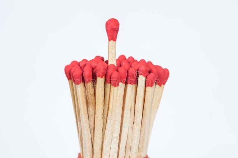 Un matchstick que se coloca encima del grupo, fotos de archivo libres de regalías