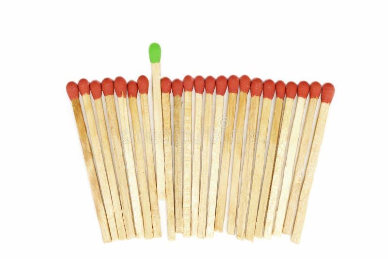 Un matchstick que se coloca hacia fuera de otro foto de archivo libre de regalías