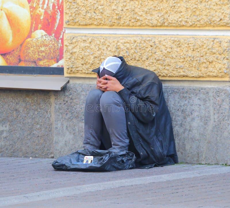 Un mendiant de rue photos stock