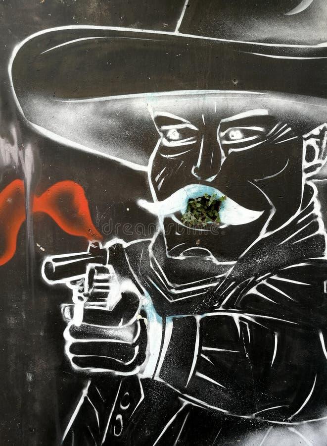 Un messicano con una pistola, graffito fotografia stock libera da diritti