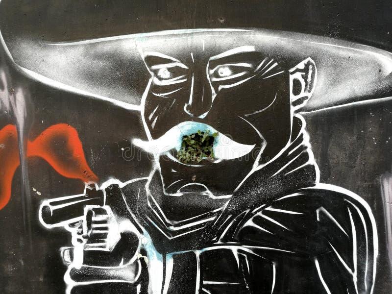 Un messicano con una pistola, graffito immagini stock libere da diritti