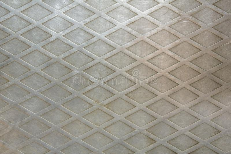 Un modelo de rejilla del diamante en el metal Textura de la superficie áspera imagenes de archivo