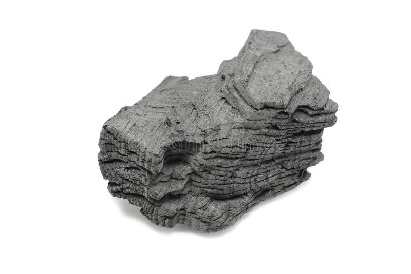 Un morceau de charbon de bois noir photo libre de droits