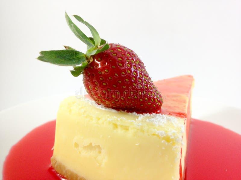 Un morceau de gâteau au fromage moite photo stock