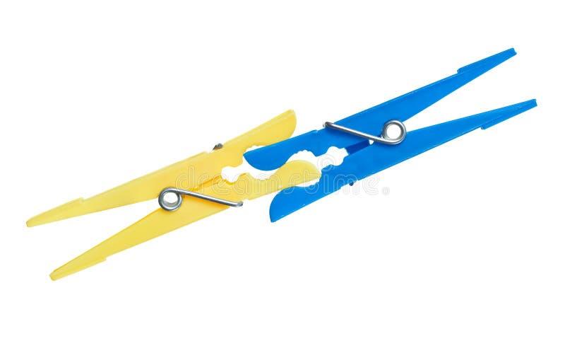 Un morso dei due clothespins immagini stock libere da diritti