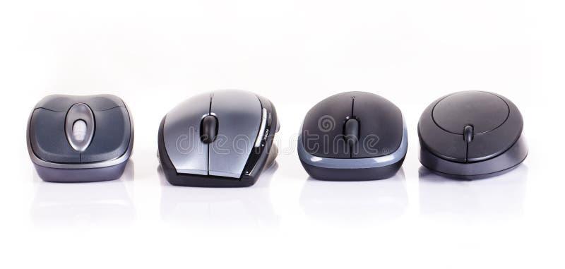 Un mouse dei quattro calcolatori immagini stock