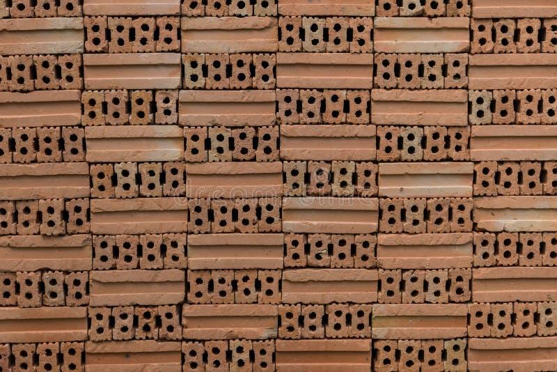 Un mucchio del pozzo sistemato ha infornato la forma dei mattoni il modello fotografie stock