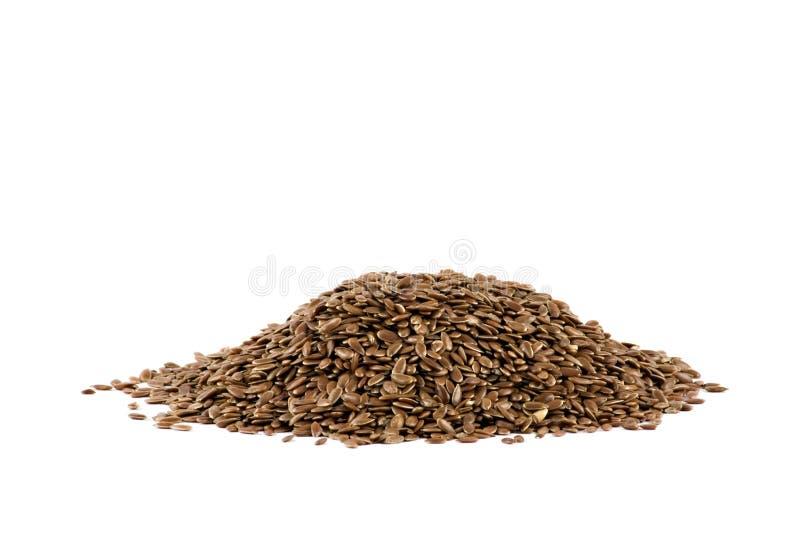 Un mucchio del seme di lino isolato su bianco immagini stock libere da diritti