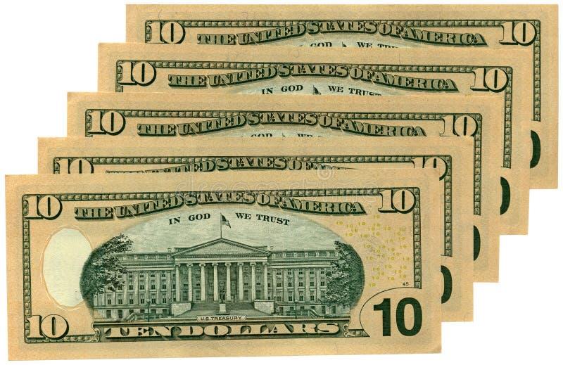 Un mucchio di dieci dollari isolati, ricchezza di risparmio immagine stock
