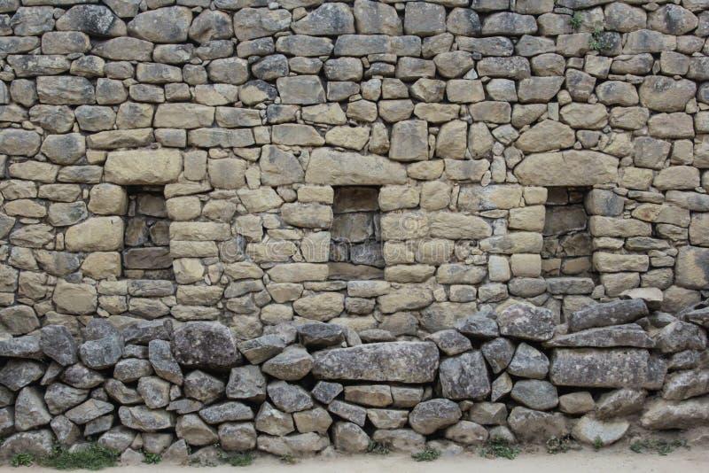 Un mur antique de la civilisation d'Inca dans Machu Pichuu Cuzco, Pérou images stock