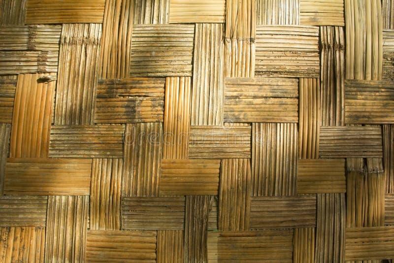 Un mur fait en texture en bambou avec des ombres photographie stock