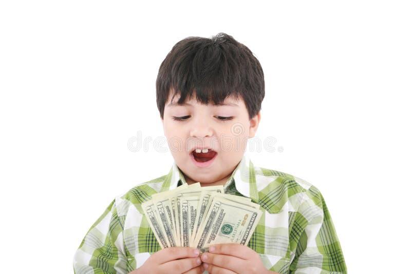 Un Niño Pequeño Sonriente Está Contando El Dinero Imagenes de archivo