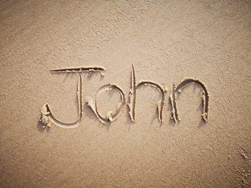 Un nome di John scritto sulla spiaggia fotografie stock
