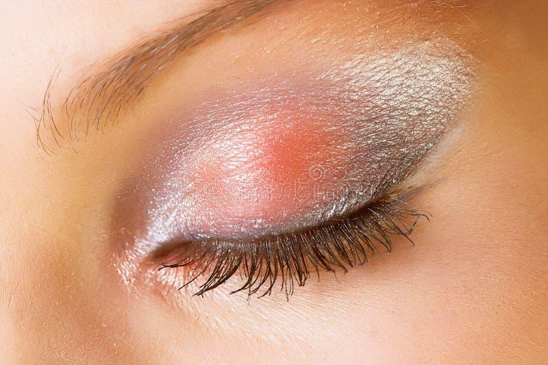 Un occhio con sparkly compone immagini stock libere da diritti