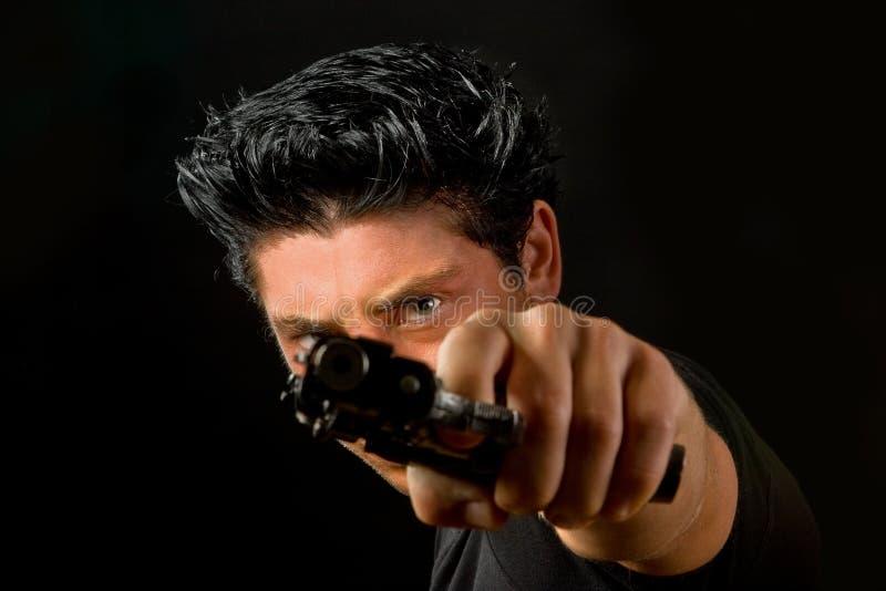 Un occhio sopra una pistola immagine stock libera da diritti