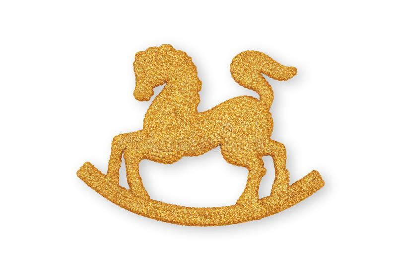 Un ornamento de oro de la Navidad del caballo mecedora para colgar en un Chris fotos de archivo