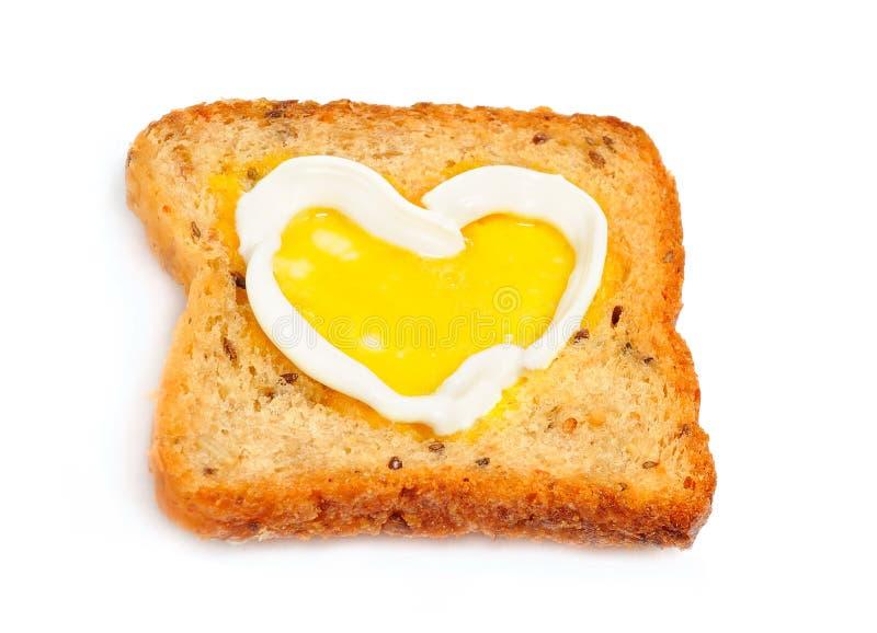 Un pain grillé avec le coeur image stock