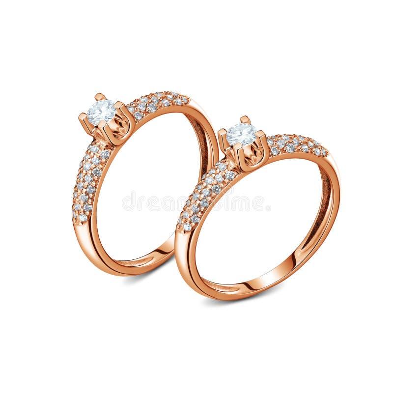 Un paio degli anelli di oro rosa del lusso con i diamanti isolati fotografia stock libera da diritti