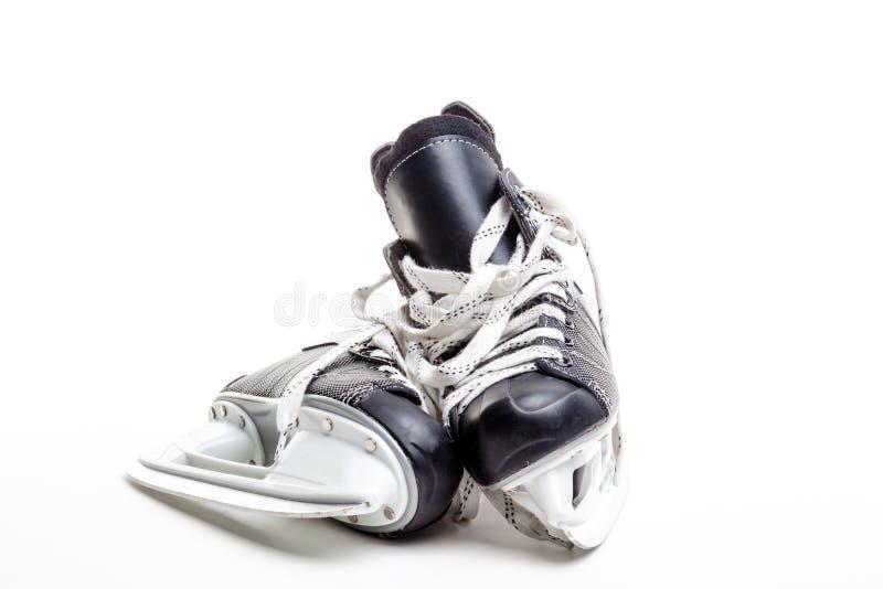 Un paio dei pattini del hockey su ghiaccio fotografia stock libera da diritti