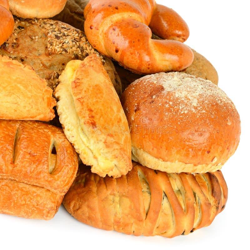 Un pan y productos de la panadería aislados en el fondo blanco Alimento sano foto de archivo