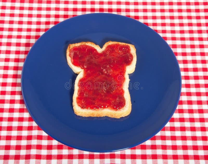 Un panino bianco con ostruzione sulla parte superiore fotografia stock libera da diritti