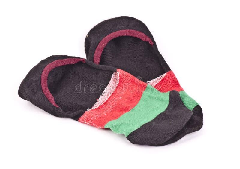 Un par de calcetines coloridos del tobillo imagenes de archivo