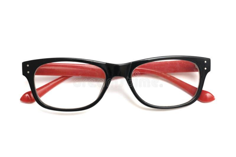 Un par de gafas decorativas coloridas con rojo coloreó los templos fotografía de archivo