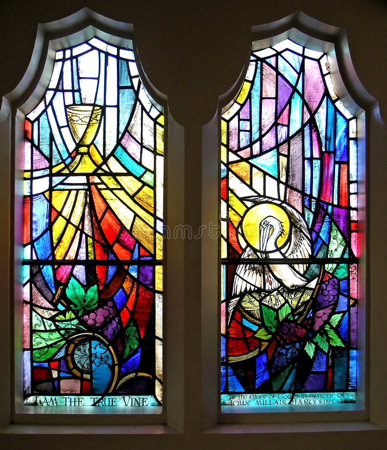 Un par de ventana de cristal manchada fotos de archivo