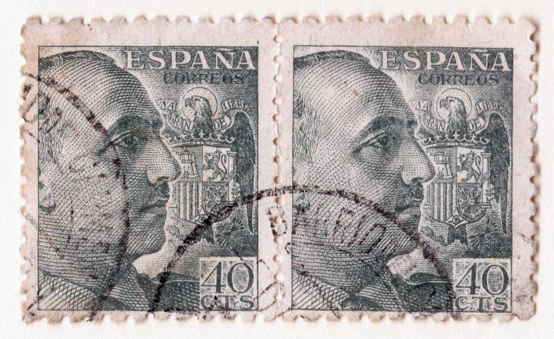 Un par de viejos sellos azules del vintage con una imagen del general franco y del símbolo español del águila fotos de archivo libres de regalías