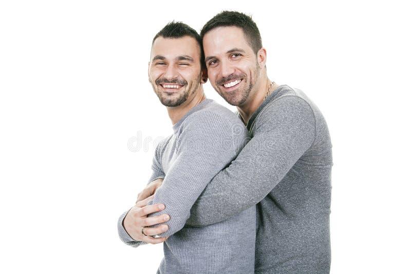 Un par homosexual sobre un fondo blanco imágenes de archivo libres de regalías